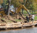Marvin Creek stream bank gets stabilized with logs to help prevent further damage from erosion and help protect the wildlife habitat.